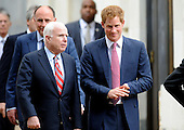 U.S. Sen. John McCain (R-AZ) (L) accompagnes HRH Prince Harry to his car after touring an anti-landmine photography exhibition by The HALO Trust charity during the first day of his visit to the United States at the Russell Senate Office Building on May 9, 2013 in Washington, DC. .Credit: Olivier Douliery / CNP