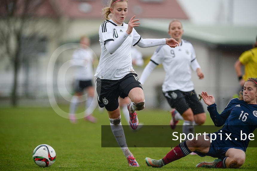 20150404 - FORST , GERMANY  : German Laura Freigang pictured being tackled by Scottish Emly McKerlie (right) during the soccer match between Women Under 19 teams of Germany and Scotland , on the first matchday in group 5 of the UEFA Elite Round Women Under 19 at WaldseeStadion , Forst , Germany . Saturday 4th April 2015 . PHOTO DAVID CATRY