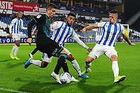 Kristoffer Peterson of Swansea City vies for possession with Elias Kachunga  and Jonathan Hogg of Huddersfield Town during the Sky Bet Championship match between Huddersfield Town and Swansea City at The John Smith's Stadium in Huddersfield, England, UK. Tuesday 26 November 2019