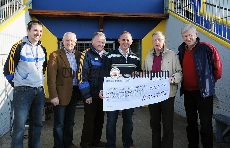 Paudie Neylon, second left, from the Clare Football Supporters Club with Sean Chaplin, Michael O' Neill and Bernard Flynn, Clare County Board, and John O' Brien and Pat Cotter from the Clare Football Supporters Club at the presentation of a cheque to the Clare County Board, which will go towards the coaching of underage football in Clare.