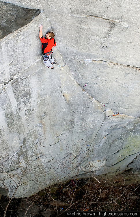 Jimmy Stout nears the top and the crux of Waste Not Want Not on Looking Glass Rock in the Pisgah National Forest.