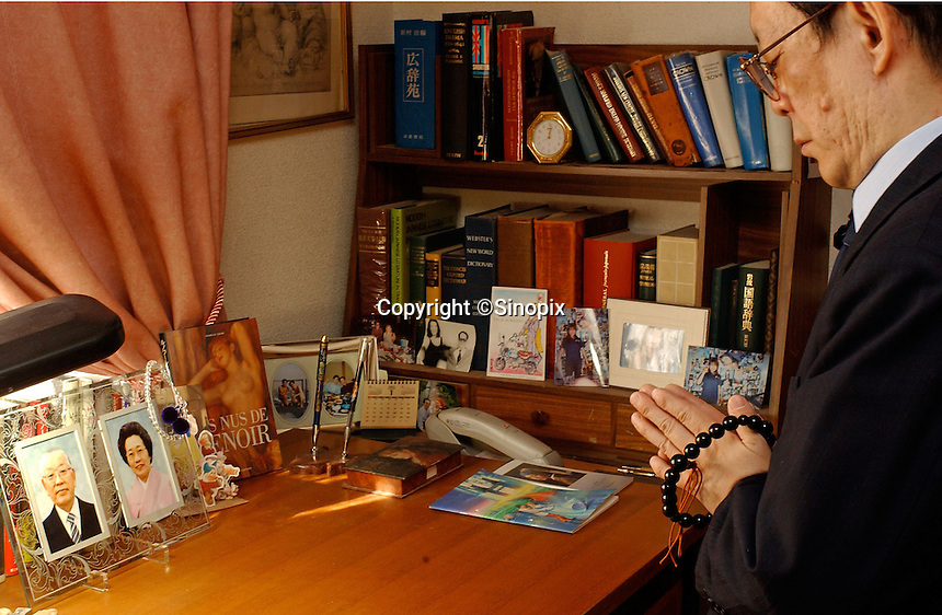 Issei Sagawa, the notorious Japanese cannibal, prays next to pictures of his deceased parents. Sagawa killed and ate  a Dutch student Renee Hartevelt while studying in Paris in 1981. He was released in Japan due to political connections after being jailed then placed in a mental institution in Paris. <br /> 14-DEC-05