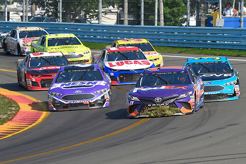 #11: Denny Hamlin, Joe Gibbs Racing, Toyota Camry FedEx Ground, #6: Matt Kenseth, Roush Fenway Racing, Ford Fusion NESN, #34: Michael McDowell, Front Row Motorsports, Ford Fusion K-LOVE RADIO