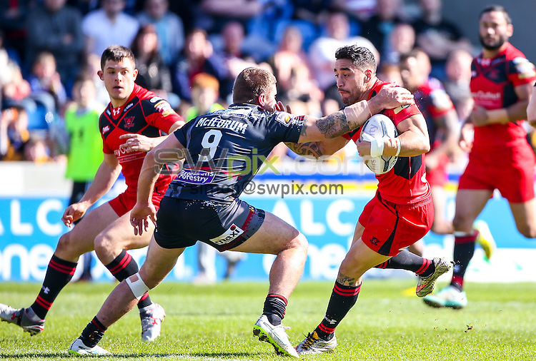 Picture by Alex Whitehead/SWpix.com - 06/04/2015 - Rugby League - First Utility Super League - Salford Red Devils v Wigan Warriors - AJ Bell Stadium, Salford, England - Salford's Rangi Chase is tackled by Wigan's Michael McIlorum.