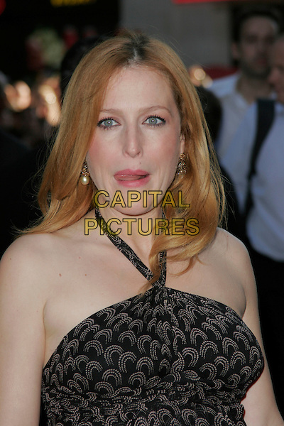 "GILLIAN ANDERSON .Arrivals - ""The X-Files: I Want to Believe"".UK  film premiere held at Empire Cinema, Leicester Square, London, England, 30th July 2008..X files portrait headshot black print halterneck funny tongue licking mouth.CAP/AH.©Adam Houghton/Capital Pictures"