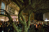 Thousands gathered for a vigil and memorial for three shooting victims at The Pit at The University of North Carolina at Chapel Hill in Chapel Hill, North Carolina on Wednesday, February 11, 2015. Craig Hicks, 46, of Chapel Hill has been charged with three counts of first-degree murder in the killings of Deah Barakat, 23, a UNC student; his wife, Yusor Abu-Salha, 21; and her sister, Razan Abu-Salha, 19. (Justin Cook)