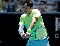 26th January 2020; Melbourne Park, Melbourne, Victoria, Australia; Australian Open Tennis, Day 7; Milos  Raonic of Canada returns during his match against Mario Cilic of Croatia