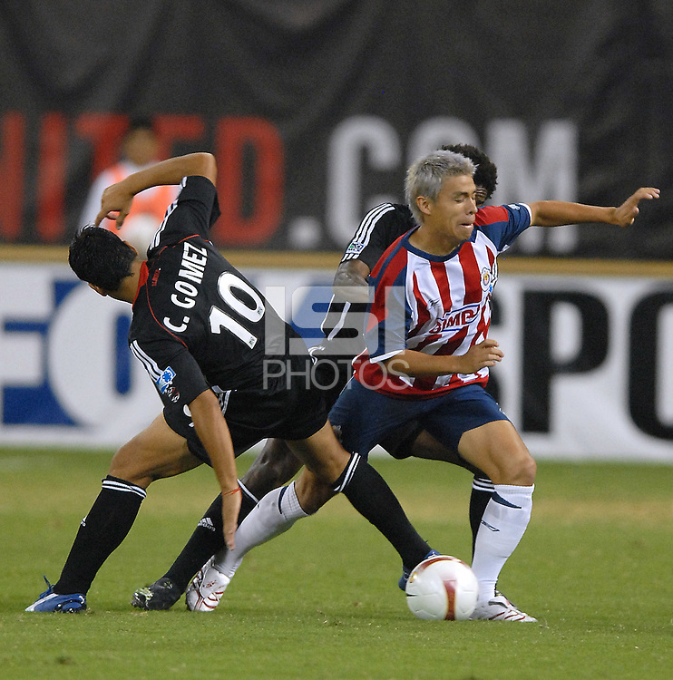 CD Chivas midfielder Gonzalo Pineda (7) being fouled by DC United midfielder Christian Gomez (10). DC United defeated CD Guadalajara 2-1 in the first game of a home and home round of 16 match in the 2007 Copa Nissan Sudamericana at RFK Stadium in Washington DC, on Wednesday September 26, 2007.