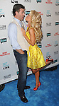 """Slade Smiley and Gretchen Rossi at the book party hosted by Bravo for """"Most Talkative Stories from the Front Line of Pop Culture"""" held at SUR Lounge in West Hollywood May 14, 2012. © Fitzroy Barrett"""