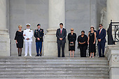 The family of late Senator John McCain looks on as a United States Military Honor Guard carries the casket of former Senator John McCain, Republican of Arizona, up the stairs of the Capitol in Washington, DC on August 31, 2018 in Washington, DC. McCain, a United States Military veteran and longtime Senator, will lay in state inside the Capitol Rotunda for one day prior to being laid to rest on September 1, 2018 at the United States Naval Academy in Annapolis, Maryland. Credit: Alex Edelman / CNP
