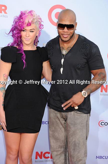 PASADENA, CA - SEPTEMBER 16: Flo Rida and Stayc Reign arrive at the 2012 NCLR ALMA Awards at Pasadena Civic Auditorium on September 16, 2012 in Pasadena, California.