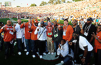 Jan 7, 2010; Pasadena, CA, USA; Texas Longhorns head coach Mack Brown (center) poses with former players on the field before the 2010 BCS national championship game against the Alabama Crimson Tide at the Rose Bowl.  Mandatory Credit: Mark J. Rebilas-