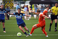 Kansas City, MO - Saturday May 07, 2016: Houston Dash defender Rebecca Moros (4) defends against FC Kansas City midfielder Mandy Laddish (7) during a regular season National Women's Soccer League (NWSL) match at Swope Soccer Village.