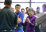 Nevada Gov. Brian Sandoval, left center, and Secretary of the Interior Sally Jewell, right, receive a briefing from fire officials on the Washington fire from a command post in Gardnerville, Nev. area on Wednesday, June 24, 2015. The lightning-caused fire near Markleeville, Ca. has grown to nearly 17,000 acres since Friday. <br /> Photo by Cathleen Allison