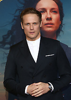 "HOLLYWOOD, CA - FEBRUARY 13: Sam Heughan, at the Premiere Of Starz's ""Outlander"" Season 5 at HHollywood Palladium in Hollywood California on February 13, 2020. Credit: Faye Sadou/MediaPunch"