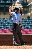 Field umpire Cody Waterhouse signals for four baseballs during a game between the Hagerstown Suns and Lexington Legends on May 19, 2014 at Whitaker Bank Ballpark in Lexington, Kentucky.  Lexington defeated Hagerstown 9-8.  (Mike Janes/Four Seam Images)