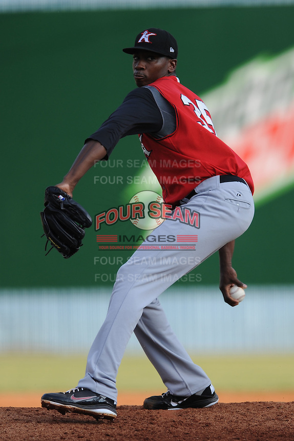 Kannapolis Intimidators pitcher Dexter Carter #35 delivers a pitch during game against the Asheville Tourists at McCormick Field on July 20, 2011 in Asheville, North Carolina. Asheville won the game 5-4.   (Tony Farlow/Four Seam Images)