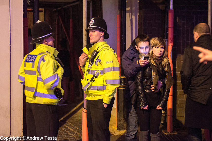 UK. Northampton. 7th December 2013<br /> Police outside NB nightclub at 3.30am as closing time approaches.<br /> &copy;Andrew Testa for the New York Times