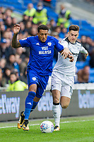 Nathaniel Mendez-Laing of Cardiff City gets past Tom Lawrence of Derby County during the Sky Bet Championship match between Cardiff City and Derby County at Cardiff City Stadium, Cardiff, Wales on 30 September 2017. Photo by Mark  Hawkins / PRiME Media Images.
