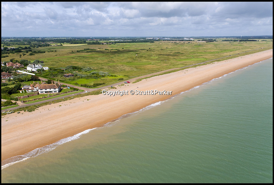 BNPS.co.uk (01202 558833)<br /> Pic: Strutt&Parker/BNPS<br /> <br /> The famous Sandwich Open golf course is next door.<br /> <br /> Tudor flat packed home just a short sand wedge from the beach AND the golf course.<br /> <br /> This stunning beachside property comes with sea views as far as Europe and a top golf course on the doorstep.<br /> <br /> Kentlands is a Grade II listed Arts & Crafts home on the private Sandwich Bay estate in Kent with direct access to a beautiful, quiet beach.<br /> <br /> The house is also right next door to the world famous Royal St George's Golf Club, one of the few courses where the British Open is held, and is expected to appeal to professional players.<br /> <br /> But you'll need a decent wedge to buy it - the property is on the market with Strutt & Parker for £3.3million.