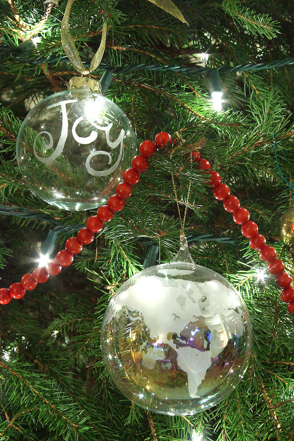 Ornaments on Christmas tree with Joy to the World theme
