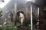 Grand mother, Haimon  and Grand Daughter ,Victoria, 54 in their bamboo house in Cherrapunji - Kutmadan Village.<br /> Despite the heavy rain the house was completely dry and they took me around to see more Bamboo houses, they were so proud of them.<br /> Giulio Di Sturco