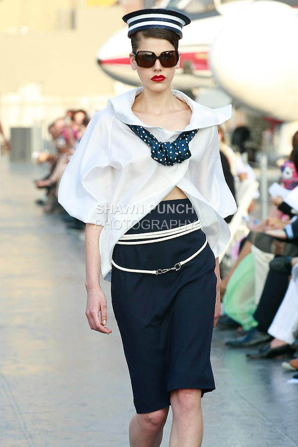 Milica walks runway in a Douglas Hannant Resort 2012 outfit, on the USS Intrepid, June 7, 2011.