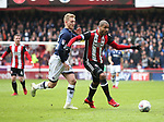 Leon Clarke of Sheffield Utd chased by George Saville of Millwall  during the championship match at the Bramall Lane Stadium, Sheffield. Picture date 14th April 2018. Picture credit should read: Simon Bellis/Sportimage