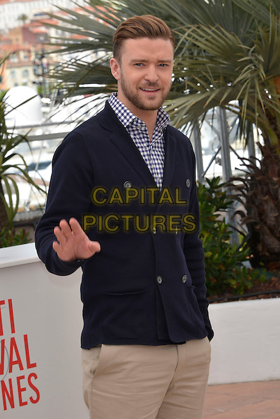Justin Timberlake.'Inside Llewyn Davis' film photocall at the 66th  Cannes Film Festival, Cannes, France, 19th May 2013..half length  beige trousers blue and white gingham shirt checked jacket navy hand in pocket waving double breasted cardigan .CAP/PL.©Phil Loftus/Capital Pictures.