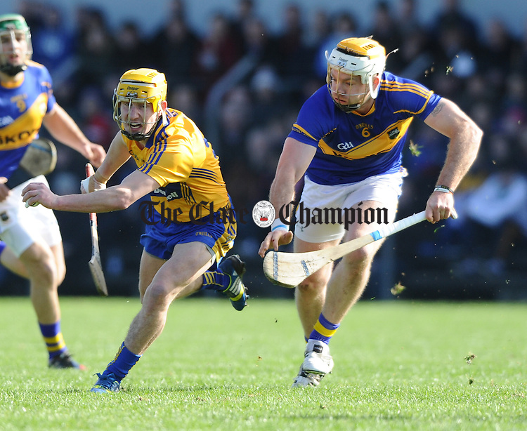 Colm Galvin of Clare in action against Padraic Maher of Tipperary during their game in Cusack park. Photograph by John Kelly.