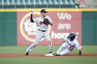 Scranton/Wilkes-Barre RailRiders second baseman Breyvic Valera (2) prepares to throw to first base after getting the force out on Nick Madrigal (3) of the Charlotte Knights at BB&T BallPark on August 14, 2019 in Charlotte, North Carolina. The Knights defeated the RailRiders 13-12 in ten innings. (Brian Westerholt/Four Seam Images)