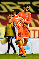 Blackpool's Kelvin Mellor celebrates with Jay Spearing<br /> <br /> Photographer Richard Martin-Roberts/CameraSport<br /> <br /> The EFL Sky Bet League One - Wigan Athletic v Blackpool - Tuesday 13th February 2018 - DW Stadium - Wigan<br /> <br /> World Copyright &not;&copy; 2018 CameraSport. All rights reserved. 43 Linden Ave. Countesthorpe. Leicester. England. LE8 5PG - Tel: +44 (0) 116 277 4147 - admin@camerasport.com - www.camerasport.com