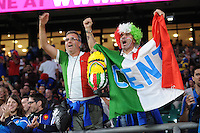 Italian fans cheer their team during Match 5 of the Rugby World Cup 2015 between France and Italy - 19/09/2015 - Twickenham Stadium, London <br /> Mandatory Credit: Rob Munro/Stewart Communications