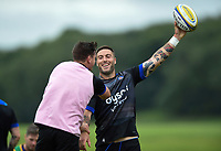 Matt Banahan of Bath Rugby looks to keep the ball away from team-mate Freddie Burns. Bath Rugby pre-season training session on July 28, 2017 at Farleigh House in Bath, England. Photo by: Patrick Khachfe / Onside Images