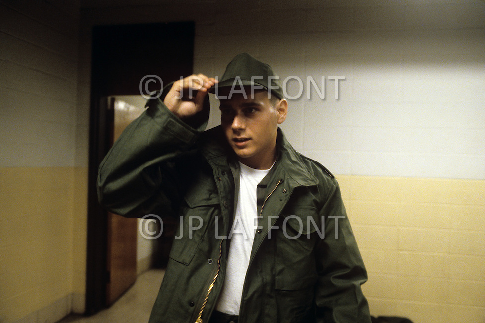 Fort Dix, NJ, USA, June 1980. A rookie wearing the uniform he just received.