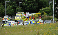 Pictured: The scene where an ice-cream van overturned after hitting a garden wall in the Blaenymaes area of Swansea, south Wales, UK<br /> Re: Driver in hospital after ice-cream van overturns in Swansea and police appeal for witnesses.<br /> The 61-year-old driver of an ice-cream van which overturned in Swansea today is receiving treatment at Morriston Hospital.<br /> Souh Wales Police are appealing for witnesses to the incident on Penplas Road, Blaenymaes, in which the van collided with a garden <br /> Three fire crews, plus paramedics and a Wales Air Ambulance helicopter crew attended the scene.