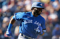 Toronto Blue Jays Anthony Alford (30) runs to first base during a Spring Training game against the New York Yankees on February 22, 2020 at the George M. Steinbrenner Field in Tampa, Florida.  (Mike Janes/Four Seam Images)