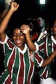 Rio de Janeiro, Brazil. Two women in Fluminense football shirts dancing; Carnival.