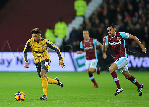 03.12.2016. London Stadium, London, England. Premier League Football. West Ham United versus Arsenal. Arsenal's Alex Oxlade-Chamberlain takes the ball past West Ham United Defender Álvaro Arbeloa, during an Arsenal attack