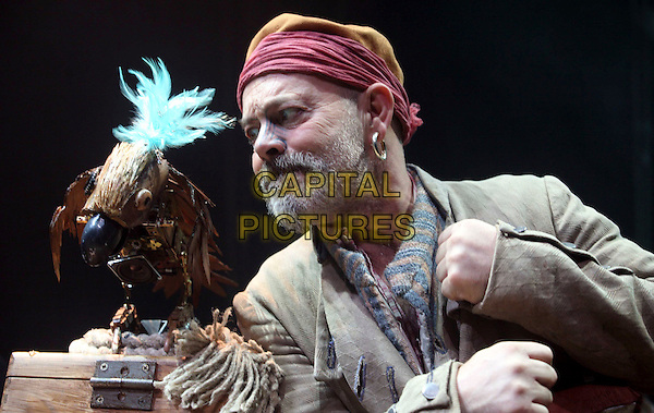 "KEITH ALLEN.Stars as Long John Silver in The Theatre Royal, Haymarket production of ""Treasure Island"" adapted from Robert Louis Stevenson's classic novel..London, England, November 14th 2008.play scene costume character half length beard facial hair headscarf earring parrot fist on stage .CAP/DS.©Dudley Smith/Capital Pictures"