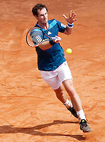 Britain's Andy Murray returns a shot against Italy's Andreas Seppi during their Davis Cup quarter-final tennis match in Naples April 5, 2014.