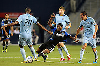 Khari Stepenson (7) forward San Jose Earthquakes stretches for the ball against, Birahim Diop (20) midfielder Sporting KC...Sporting KC defeated San Jose Earthquakes 1-0 at LIVESTRONG Sporting Park, Kansas City ,Kansas,..