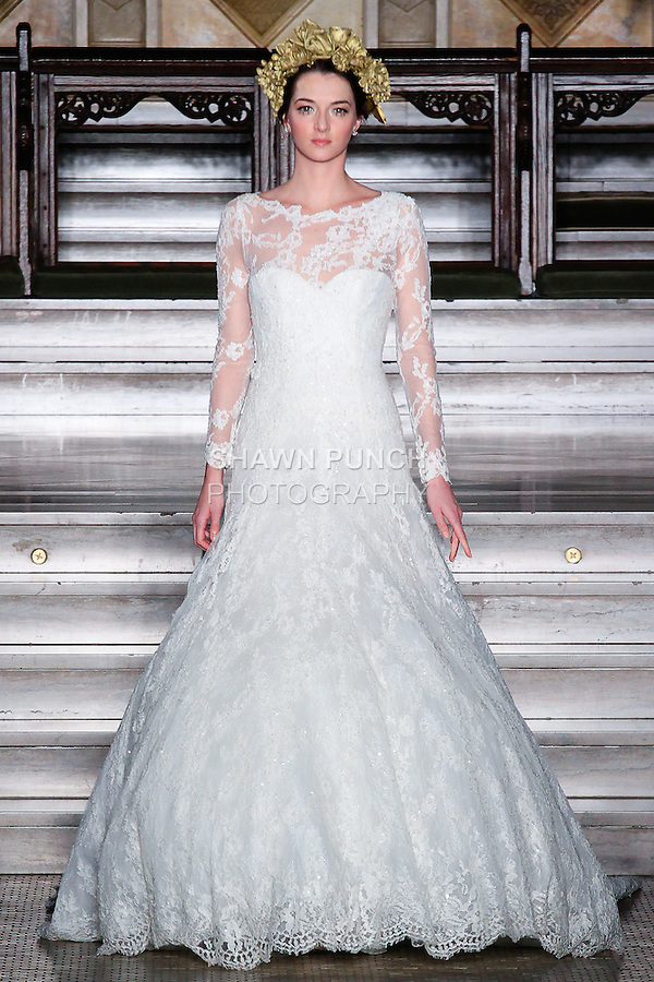 Model walks runway in a Yesuru bridal gown from the Atelier Pronovias 2014 collection by Pronovias, at St. James' Church in New York City, on November 12, 2013.