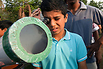 Rohit Pathan (11) uses a telescope to safely  observe the longest solar eclipse this century. The eclipse drew big crowds to New Delhi's Nehru Planatarium to see the spectacular views of the moon passing the face of the sun. The eclipse was seen across India before focus shifted towards China and Japan. Many people stayed indoors for supersticious reasons whilst others celebrated with prayer and ceremony.