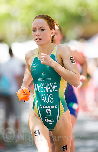 01 JUN 2013 - MADRID, ESP - Charlotte McShane (AUS) of Australia heads for transition at the end of the swim during the elite women's ITU 2013 World Triathlon Series round in Casa de Campo, Madrid, Spain   (PHOTO (C) 2013 NIGEL FARROW)