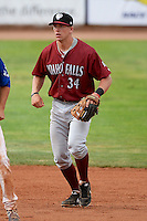 Idaho Falls Chukars shortstop Hunter Dozier#34 on defense against the Ogden Raptors at Lindquist Field on June 23, 2013 in Ogden, Utah. (Stephen Smith/Four Seam Images)