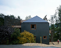 A spectacular contemporary house merges brilliantly with its surroundings being constructed of local stone and slate.