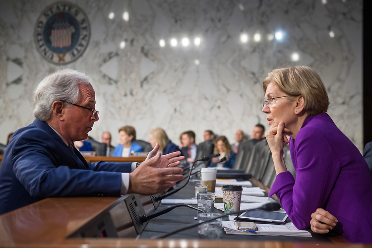 UNITED STATES - FEBRUARY 08: Sens. Elizabeth Warren, D-Mass., and Bob Corker, R-Tenn., attend a Senate Armed Services Committee hearing on nominations in Hart Building on February 8, 2018. (Photo By Tom Williams/CQ Roll Call)