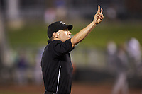 Home plate umpire Harrison Silverman signals to the press box that the Bowling Green Hot Rods have used their second mound visit during the game against the Dayton Dragons at Fifth Third Field on June 8, 2018 in Dayton, Ohio. The Hot Rods defeated the Dragons 11-4.  (Brian Westerholt/Four Seam Images)