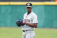 Charleston RiverDogs starting pitcher Luis Severino (6) warms up in the outfield prior to the game against the Hickory Crawdads at L.P. Frans Stadium on May 25, 2014 in Hickory, North Carolina.  The RiverDogs defeated the Crawdads 17-10.  (Brian Westerholt/Four Seam Images)